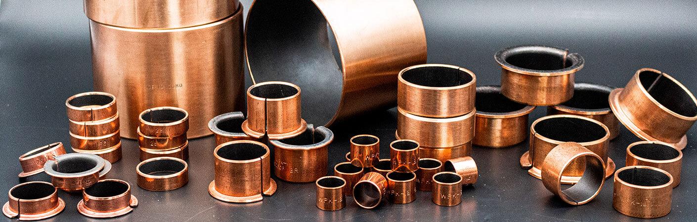 Gleitlager der WPK1-B-Serie in Form von Zylinderbuchsen und Bundbuchsen